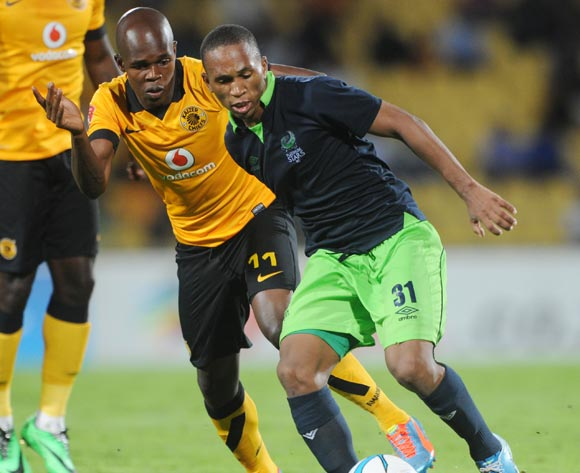 Luvolwethu Mpeta of Platinum Stars battles with Knowledge Musona of Kaizer Chiefs during the Absa Premiership 2013/14 match between Platinum Stars and Kaizer Chiefs at Royal Bafokeng Stadium in Rustenburg on the 12 March 2014