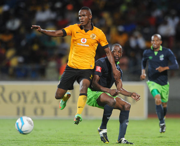 Benson Mhlongo of Platinum Stars challenged by Siboniso Gaxa of Kaizer Chiefs during the Absa Premiership 2013/14 match between Platinum Stars and Kaizer Chiefs at Royal Bafokeng Stadium in Rustenburg on the 12 March 2014