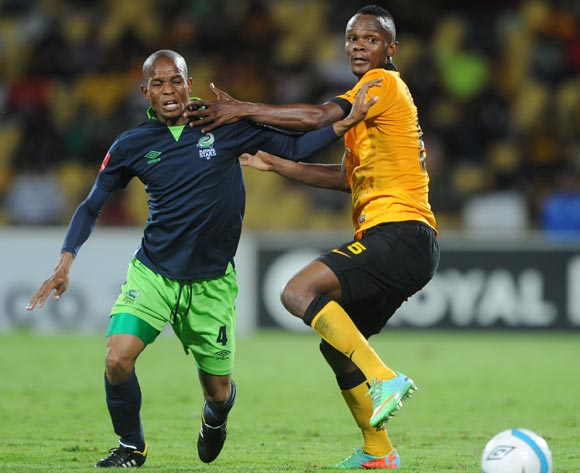 Elias Ngwepe of Platinum Stars battles with Siboniso Gaxa of Kaizer Chiefs during the Absa Premiership 2013/14 match between Platinum Stars and Kaizer Chiefs at Royal Bafokeng Stadium in Rustenburg on the 12 March 2014