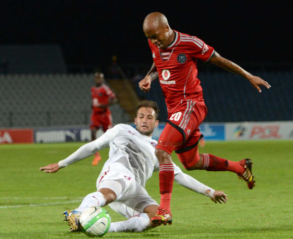 Oupa Manyisa of Orlando Pirates tussles for the ball with Larry Cohen of Moroka Swallows during the Absa Premiership match between Moroka Swallows and Orlando Pirates on the 12 March 2014 at Dobsonville Stadium