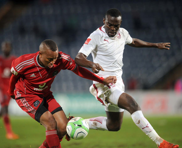 Lehlohonolo Majoro of Orlando Pirates tussles for the ball with Gilbert Mapemba of Moroka Swallows during the Absa Premiership match between Moroka Swallows and Orlando Pirates on the 12 March 2014 at Dobsonville Stadium