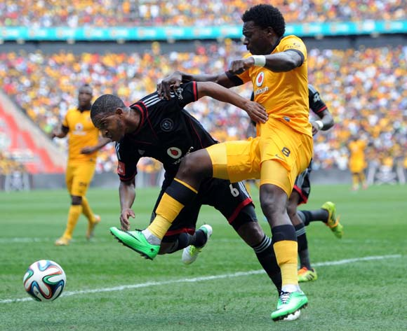 Kingston Nkhatha of Kaizer Chiefs tussles for the ball with Thandani Ntshumayelo of Orlando Pirates  during the Absa Premiership match between Orlando Pirates and Kaizer Chiefs on the 15 March 2014 at FNB Stadium