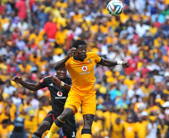 Kingston Nkhatha of Kaizer Chiefs challenged by Ntshikelelo Nyauza of Orlando Pirates during the Absa Premiership football match between Orlando Pirates and Kaizer Chiefs at the FNB Stadium, Johannesburg on 15 March 2014