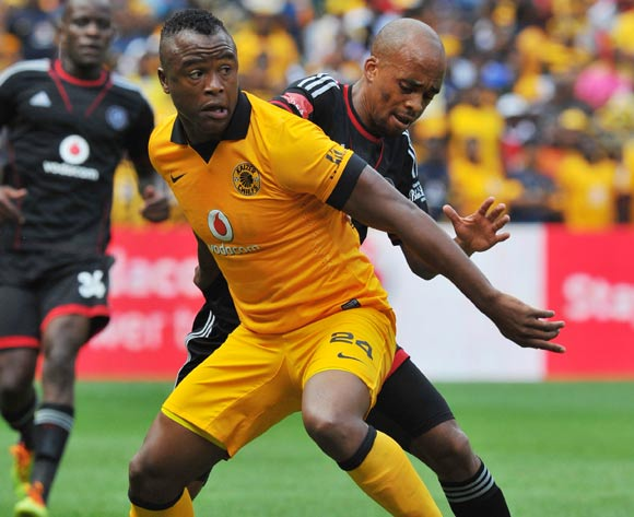 Tsepo Masilela of Kaizer Chiefs challenged by Oupa Manyisa of Orlando Pirates during the Absa Premiership football match between Orlando Pirates and Kaizer Chiefs at the FNB Stadium, Johannesburg on 15 March 2014