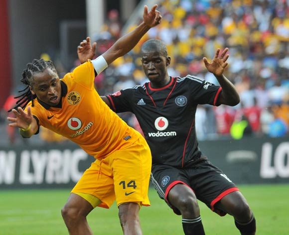 Siphiwe Tshabalala of Kaizer Chiefs challenged by Sifiso Myeni of Orlando Pirates during the Absa Premiership football match between Orlando Pirates and Kaizer Chiefs at the FNB Stadium, Johannesburg on 15 March 2014