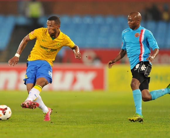 Mzikayise Mashaba of Mamelodi Sundowns challenged by Sipho Jembula of Polokwane City during the Absa Premiership football match between Mamelodi Sundowns and Polokwane City at the Loftus Stadium, Pretoria on 15 March 2014
