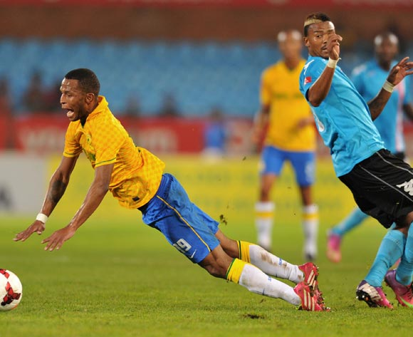 Mzikayise Mashaba of Mamelodi Sundowns challenged by Vusi Mthimkulu of Polokwane City during the Absa Premiership football match between Mamelodi Sundowns and Polokwane City at the Loftus Stadium, Pretoria on 15 March 2014