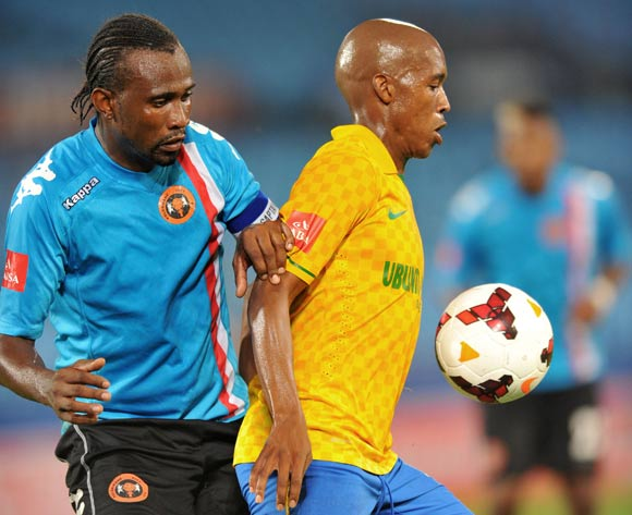 Lebohang Mokoena of Mamelodi Sundowns challenged by Thapelo Tshilo of Polokwane City during the Absa Premiership football match between Mamelodi Sundowns and Polokwane City at the Loftus Stadium, Pretoria on 15 March 2014