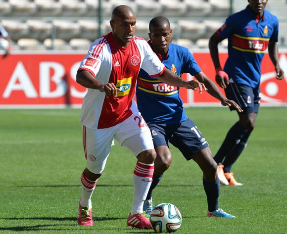Aidan Jenniker of Ajax Cape Town gets away from Thabo Mosadi of University of Pretoria during the Absa Premiership 2013/14 football match between Ajax Cape Town and University of Pretoria at Athlone Stadium, Cape Town on 16 March 2014