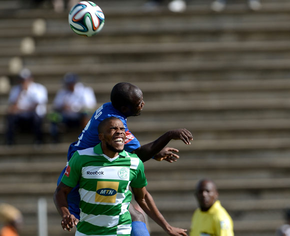 Wandisile Letlabike of Bloemfontein Celtic FC and Sibusiso Khumalo of Supersport United FC during the Absa Premiership match between Bloemfontein Celtic FC and Supersport United FC at the Kaizer Sebothelo Stadium on 16 March 2014
