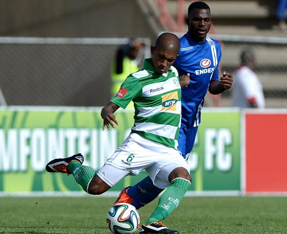 Keagan Buchanan of Bloemfontein Celtic FC and Enocent Mkhabela of Supersport United FC during the Absa Premiership match between Bloemfontein Celtic FC and Supersport United FC at the Kaizer Sebothelo Stadium on 16 March 2014