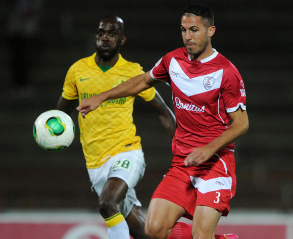 Daniel Cardoso of Free State Stars challenged by Anthony Laffor of Mamelodi Sundowns during theAbsa Premiership 2013/14 match between Free State Stars and Mamelodi Sundowns at Charles Mopeli Stadium in Qwa Qwa on the 18 March 2014