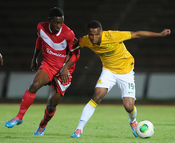 Mzikayise Mashaba of Mamelodi Sundowns battles with Moeketsi Sekola of Free State Stars during theAbsa Premiership 2013/14 match between Free State Stars and Mamelodi Sundowns at Charles Mopeli Stadium in Qwa Qwa on the 18 March 2014