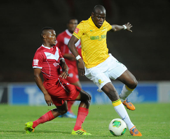 Hlompho Kekana of Mamelodi Sundowns battles with Angelo Kerspuy of Free State Stars during theAbsa Premiership 2013/14 match between Free State Stars and Mamelodi Sundowns at Charles Mopeli Stadium in Qwa Qwa on the 18 March 2014