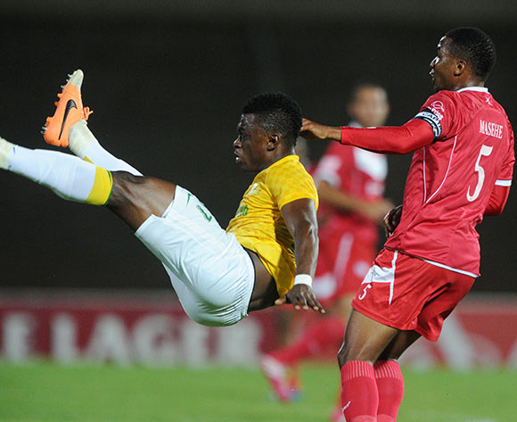 Rashid Sumaila of Mamelodi Sundowns clears the ball away from Paulus Masehe of Free State Stars during theAbsa Premiership 2013/14 match between Free State Stars and Mamelodi Sundowns at Charles Mopeli Stadium in Qwa Qwa on the 18 March 2014