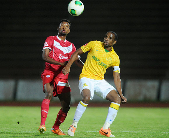 Surprise Moriri of Mamelodi Sundowns challenged by Bokang Tlhone of Free State Stars during theAbsa Premiership 2013/14 match between Free State Stars and Mamelodi Sundowns at Charles Mopeli Stadium in Qwa Qwa on the 18 March 2014