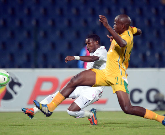 Vuyisile Wana of Moroka Swallows tussles with Nkanyiso Mngwengwe of Golden Arrows during the Absa Premiership match between Moroka Swallows and Golden Arrows Stars on the 18 March 2014 at Dobsonville Stadium