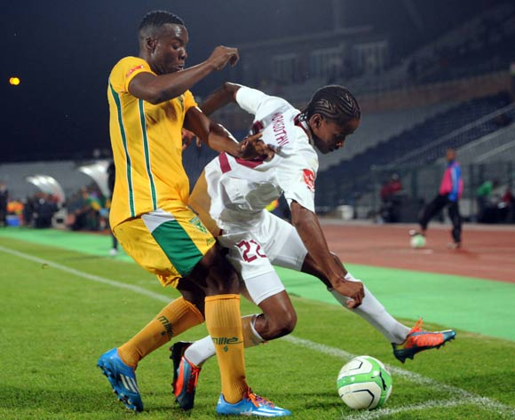 Siyanda Zwane of Golden Arrows tussles for possession with Levy Mokgothu of Moroka Swallows during the Absa Premiership match between Moroka Swallows and Golden Arrows Stars on the 18 March 2014 at Dobsonville Stadium
