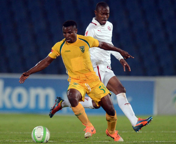 Asavela Mbekile of Moroka Swallows tussles with Christopher Katongo of Golden Arrows during the Absa Premiership match between Moroka Swallows and Golden Arrows Stars on the 18 March 2014 at Dobsonville Stadium