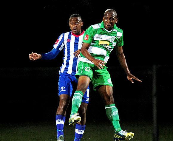 Thokozani Sekotlong of Maritzburg United and Alfred Ndengane of Bloemfontein Celtic during the Absa Premiership football match between Maritzburg United and Bloemfontein Celtic at Harry Gwala Stadium in Pietermaritzburg on March 19, 2014