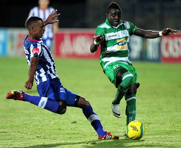 David Booysen of Maritzburg United and Gabadinho Mhango of Bloemfontein Celtic during the Absa Premiership football match between Maritzburg United and Bloemfontein Celtic at Harry Gwala Stadium in Pietermaritzburg on March 19, 2014