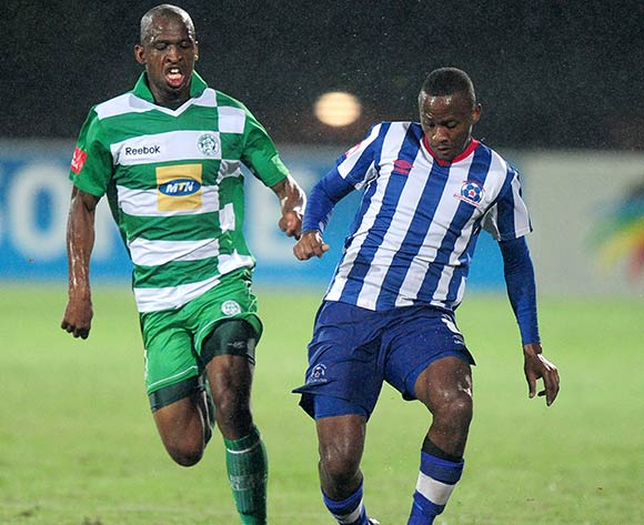 Alfred Ndengane of Bloemfontein Celtic and Thokozani Sekotlong of Maritzburg United during the Absa Premiership football match between Maritzburg United and Bloemfontein Celtic at Harry Gwala Stadium in Pietermaritzburg on March 19, 2014