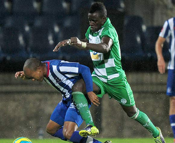 Kurt Lentjies of Maritzburg United and Gabadinho Mhango of Bloemfontein Celtic fighting to get to the ball during the Absa Premiership football match between Maritzburg United and Bloemfontein Celtic at Harry Gwala Stadium in Pietermaritzburg on March 19,