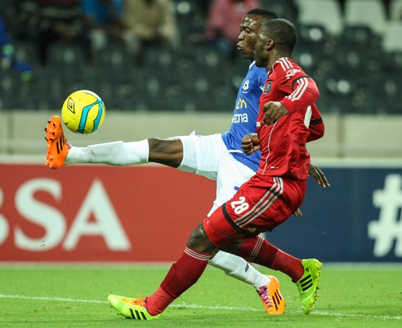 Tendai Ndoro of Black Aces and Rooi Mahamutsa of Orlando Pirates during the Absa Premiership 2013/2014 match between the Mpumalanga Black Aces and Orlando Pirates at the Mbombela Stadium on Tuesday 18 March 2014.