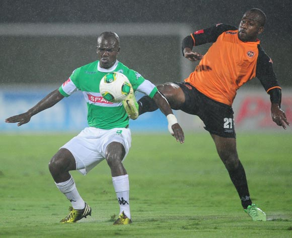 Sandile Sibande of Polokwane City battles Goodman Dlamini of AmaZulu during the Absa Premiership 2013/14 football match between AmaZulu and Polokwane City at the Princess Magogo Stadium in Durban , Kwa-Zulu Natal on the 19th of March 2014