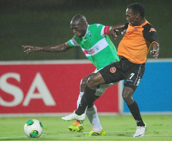 Carlington Nyadombo of AmaZulu battles Thabo Rakhale of Polokwane City during the Absa Premiership 2013/14 football match between AmaZulu and Polokwane City at the Princess Magogo Stadium in Durban , Kwa-Zulu Natal on the 19th of March 2014