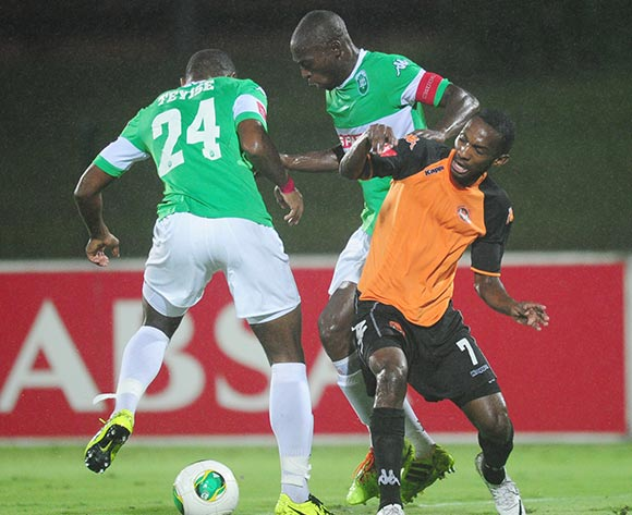 Thabo Rakhale of Polokwane City battles Carlington Nyadombo and Tamsanqa Teyise of AmaZulu during the Absa Premiership 2013/14 football match between AmaZulu and Polokwane City at the Princess Magogo Stadium in Durban , Kwa-Zulu Natal on the 19th of March