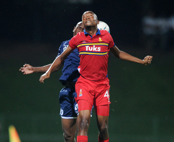 Thabo Mnyamane of University Pretoria battles with Siyabonga Nhlapho of Bidvest Wits during theAbsa Premiership 2013/14 match between University of Pretoria and Bidvest Wits at Tuks Stadium in Pretoria on the 19 March 2014