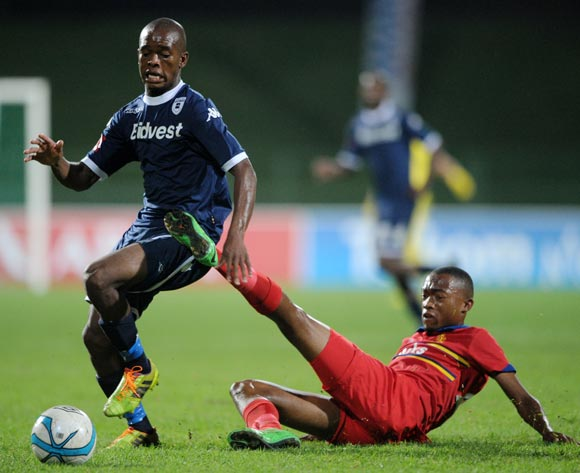 Phumlani Ntshangase of Bidvest Wits tackled by Thabo Mnyamane of University Pretoria during theAbsa Premiership 2013/14 match between University of Pretoria and Bidvest Wits at Tuks Stadium in Pretoria on the 19 March 2014