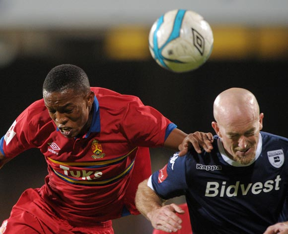 Matthew Booth of Bidvest Wits battles with Grant kekane of University Pretoria during theAbsa Premiership 2013/14 match between University of Pretoria and Bidvest Wits at Tuks Stadium in Pretoria on the 19 March 2014