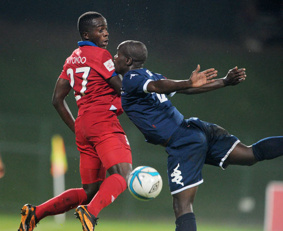 Atusaye Nyondo of University of Pretoria battles with Sboniso Gumede of Bidvest Wits during theAbsa Premiership 2013/14 match between University of Pretoria and Bidvest Wits at Tuks Stadium in Pretoria on the 19 March 2014