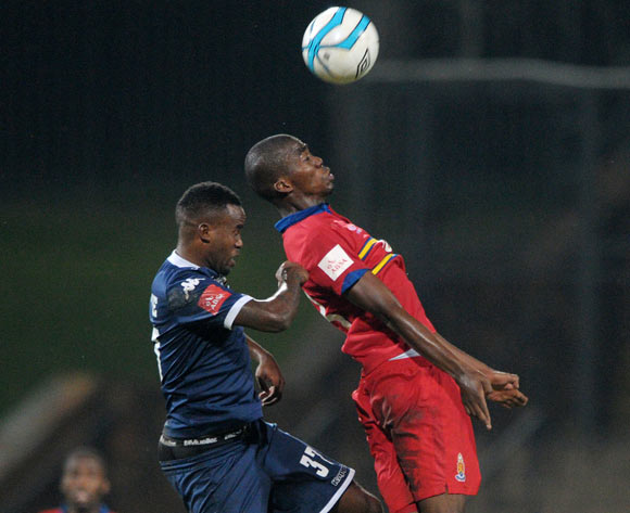 Mpho Matsi of University Pretoria battles with Jabulani Shongwe of Bidvest Wits during theAbsa Premiership 2013/14 match between University of Pretoria and Bidvest Wits at Tuks Stadium in Pretoria on the 19 March 2014