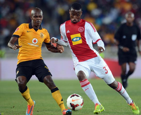Knowledge Musona of Kaizer Chiefs battles with Thamsanqa Sangweni of Ajax Cape Town during the Absa Premiership match between Kaizer Chiefs and Ajax Cape Town on the 19 March 2014 at Peter Mokaba Stadium