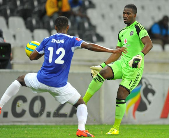 Senzo Meyiwa of Orlando Pirates challenged by Themba Zwane of Black Aces during the Absa Premiership football match between Black Aces and Orlando Pirates at the Mbombela Stadium, Nelspruit on 18 March 2014