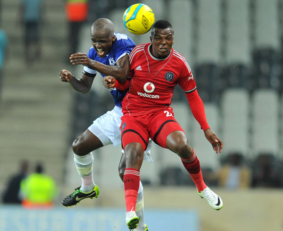 Khethowakhe Masuku of Orlando Pirates challenged by Zumuxolo Ngalo of Black Aces during the Absa Premiership football match between Black Aces and Orlando Pirates at the Mbombela Stadium, Nelspruit on 18 March 2014