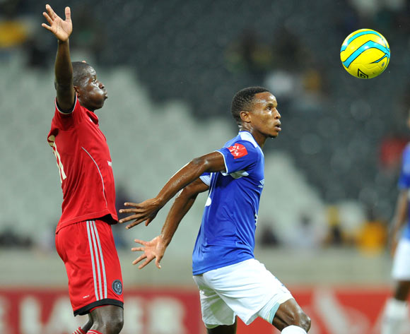 Themba Zwane of Black Aces challenged by Sifiso Myeni of Orlando Pirates during the Absa Premiership football match between Black Aces and Orlando Pirates at the Mbombela Stadium, Nelspruit on 18 March 2014