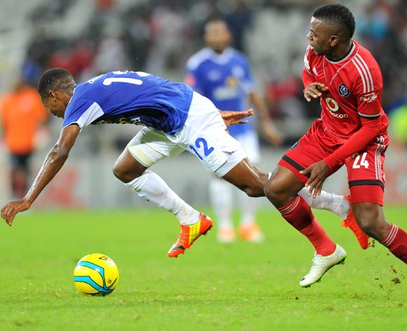 Themba Zwane of Black Aces challenged by Khethowakhe Masuku of Orlando Pirates during the Absa Premiership football match between Black Aces and Orlando Pirates at the Mbombela Stadium, Nelspruit on 18 March 2014