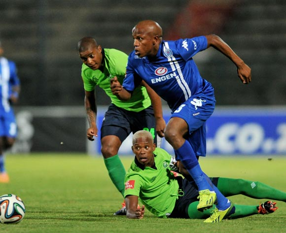 Lebohang Manyama of Supersport United challenged by Vuyo Mere of Platinum Stars during the Absa Premiership football match between Supersport United and Platinum Star at the Lucas Moripe Stadium, Pretoria on 19 March 2014