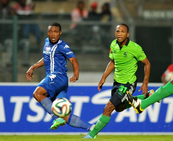 Thuso Phala of Supersport United challenged by Luvolwethu Mpeta of Platinum Stars during the Absa Premiership football match between Supersport United and Platinum Star at the Lucas Moripe Stadium, Pretoria on 19 March 2014