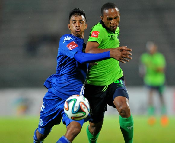 Luvolwethu Mpeta of Platinum Stars challenged by Doutie Sameehg of Supersport United during the Absa Premiership football match between Supersport United and Platinum Star at the Lucas Moripe Stadium, Pretoria on 19 March 2014