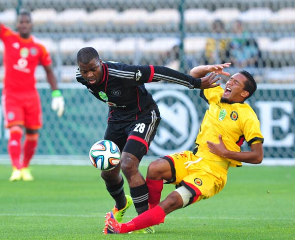 Rooi Mahamutsa of Orlando Pirates hands off Zaakier Williams of Santos during the 2014 Nedbank Cup game between Santos and Orlando Pirates at Athlone Stadium, Cape Town on 21 March 2014
