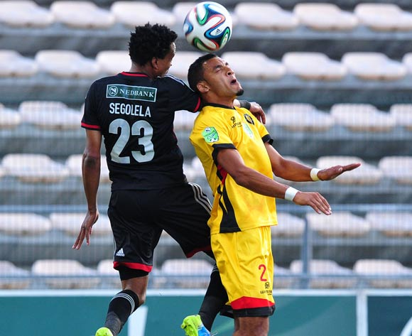 Tlou Segolela of Orlando Pirates and Sachin Dawood of Santos battle in the air during the 2014 Nedbank Cup game between Santos and Orlando Pirates at Athlone Stadium, Cape Town on 21 March 2014