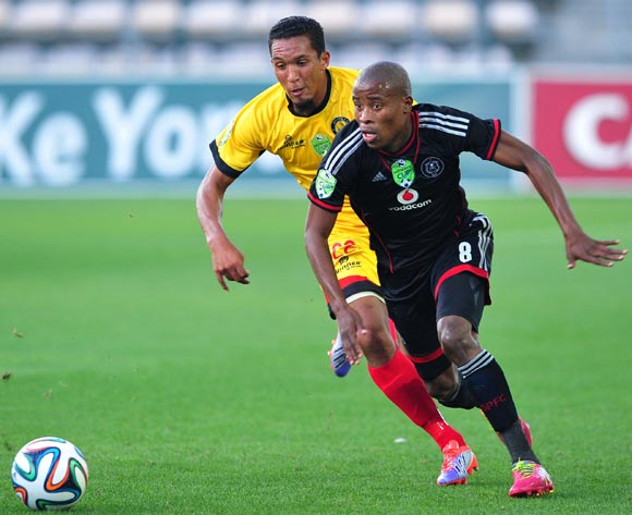 Thabo Matlaba of Orlando Pirates pulls away from Zaakier Williams of Santos during the 2014 Nedbank Cup game between Santos and Orlando Pirates at Athlone Stadium, Cape Town on 21 March 2014