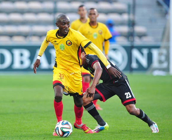 Xolani Mdaki of Santos controls the ball ahead of Tlou Segolela of Orlando Pirates during the 2014 Nedbank Cup game between Santos and Orlando Pirates at Athlone Stadium, Cape Town on 21 March