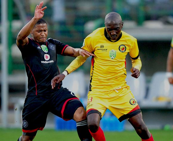 Thandani Ntshumayelo of Orlando Pirates and Xolani Mdaki of Santos battle for possession during the 2014 Nedbank Cup game between Santos and Orlando Pirates at Athlone Stadium, Cape Town on 21 March 2014
