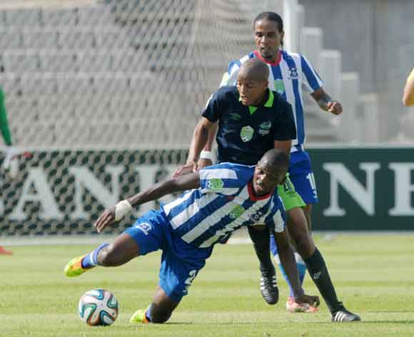 Solomon Mathe of Platinum Stars battles with Thamsanqa Mkhize of Maritzburg United during the 2014 Nedbank Cup match between Platinum Stars and Maritzburg United at Moruleng Stadium in Rustenburg on the 22 March 2014 ©Muzi Ntombela/BackpagePix
